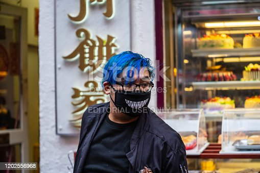 1202557009istockphoto People wearing a face masks to protecting themself because of epidemic in China. Selective Focus. Concept of coronavirus quarantine. 1202556968