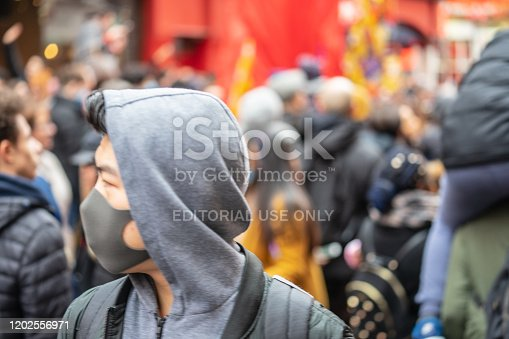 1202557009istockphoto People wearing a face masks to protecting themself because of epidemic in China. Selective Focus. Concept of coronavirus quarantine. 1202556971