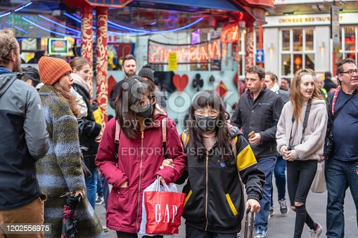 1202557009istockphoto People wearing a face masks to protecting themself because of epidemic in China. Selective Focus. Concept of coronavirus quarantine. 1202556975