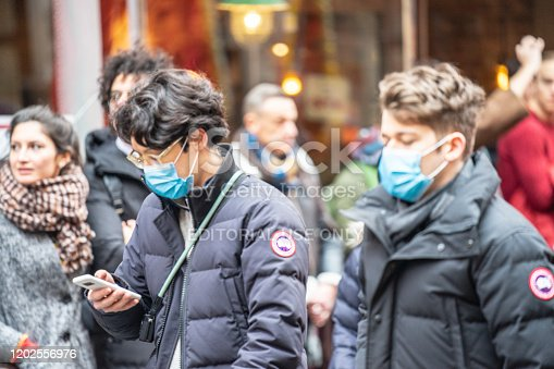 1202557009istockphoto People wearing a face masks to protecting themself because of epidemic in China. Selective Focus. Concept of coronavirus quarantine. 1202556976