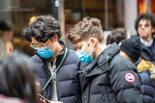 London, January 26, 2020. People wearing a face masks to protecting themself because of epidemic in China. Selective Focus. Concept of coronavirus quarantine. MERS-Cov, middle East respiratory syndrome coronavirus, Novel coronavirus 2019-nCoV.