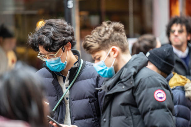 people wearing a face masks to protecting themself because of epidemic in china. selective focus. concept of coronavirus quarantine. - sars foto e immagini stock