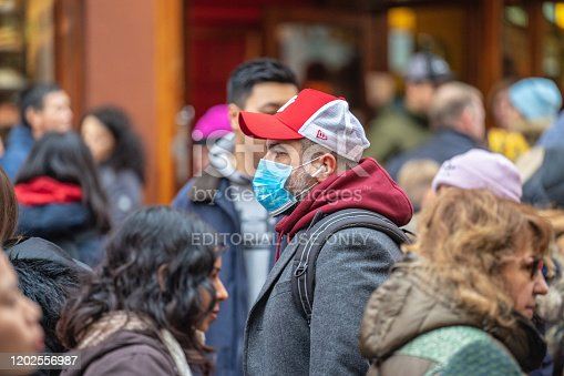 1202557009istockphoto People wearing a face masks to protecting themself because of epidemic in China. Selective Focus. Concept of coronavirus quarantine. 1202556987