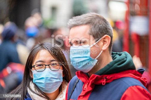 1202557009istockphoto People wearing a face masks to protecting themself because of epidemic in China. Selective Focus. Concept of coronavirus quarantine. 1202556989