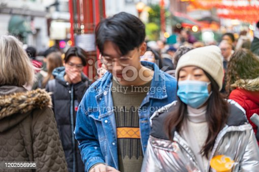 1202557009istockphoto People wearing a face masks to protecting themself because of epidemic in China. Selective Focus. Concept of coronavirus quarantine. 1202556998