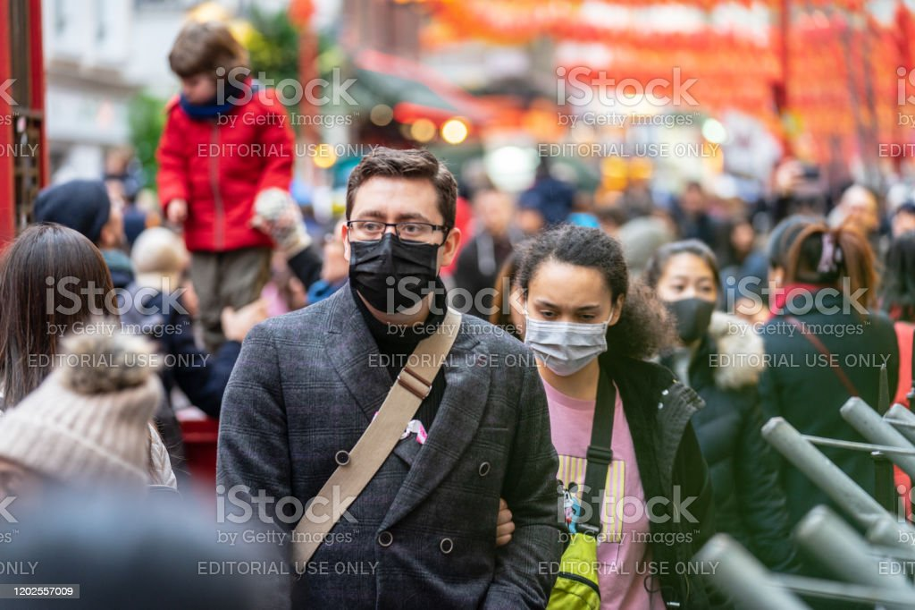 People wearing a face masks to protecting themself because of epidemic in China. Selective Focus. Concept of coronavirus quarantine. - Foto stock royalty-free di Batterio