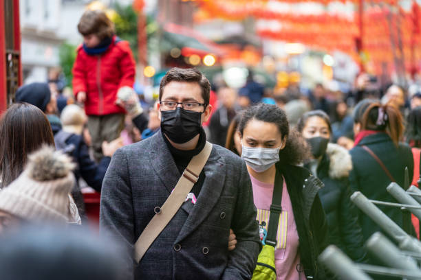 People wearing a face masks to protecting themself because of epidemic in China. Selective Focus. Concept of coronavirus quarantine. London, January 26, 2020. People wearing a face masks to protecting themself because of epidemic in China. Selective Focus. Concept of coronavirus quarantine. MERS-Cov, middle East respiratory syndrome coronavirus, Novel coronavirus 2019-nCoV. covid mask stock pictures, royalty-free photos & images