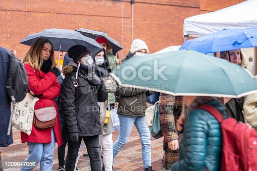 1202557009istockphoto People wearing a face masks to protecting themself because of epidemic COVID-19 in China.Motion blur. Selective Focus. Concept of coronavirus quarantine. 1209647056