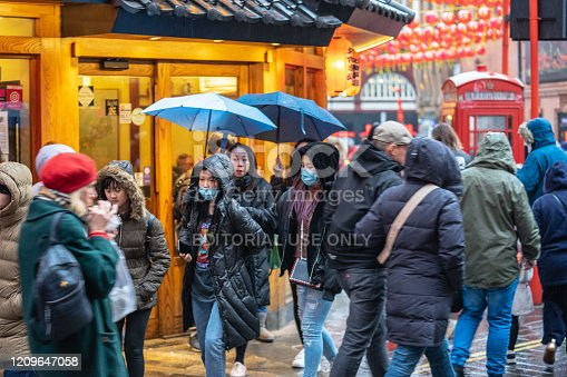 1202557009istockphoto People wearing a face masks to protecting themself because of epidemic COVID-19 in China.Motion blur. Selective Focus. Concept of coronavirus quarantine. 1209647058