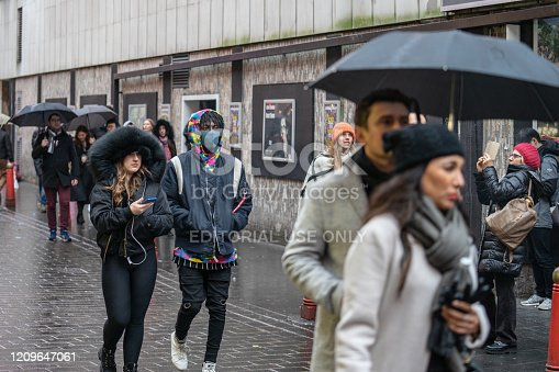 1202557009istockphoto People wearing a face masks to protecting themself because of epidemic COVID-19 in China. Selective Focus. Concept of coronavirus quarantine. 1209647061