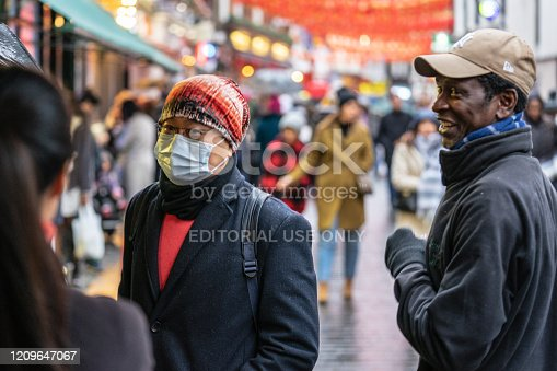 1202557009istockphoto People wearing a face masks to protecting themself because of epidemic COVID-19 in China.Motion blur. Selective Focus. Concept of coronavirus quarantine. 1209647067