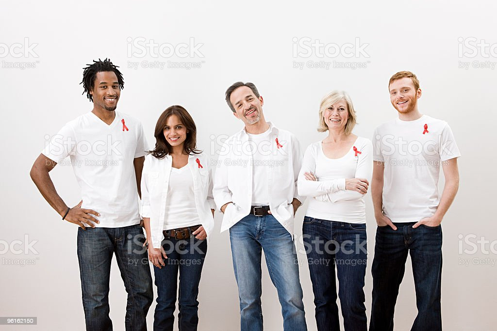 People wearing aids awareness ribbons stock photo