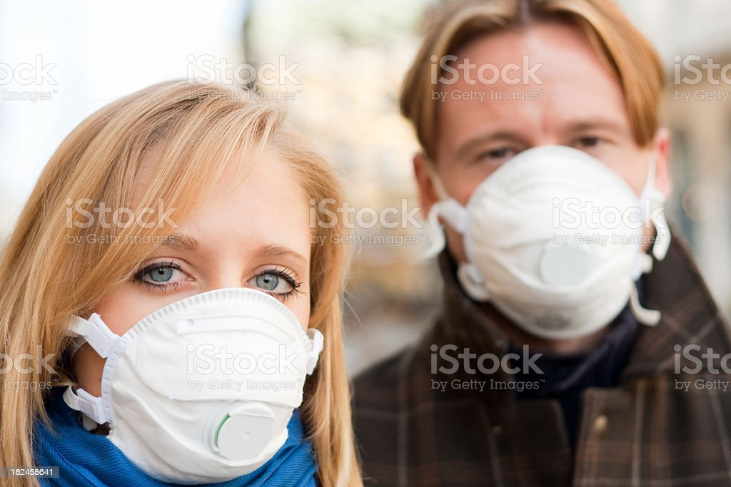 people wearing flu protection masks royalty-free stock photo