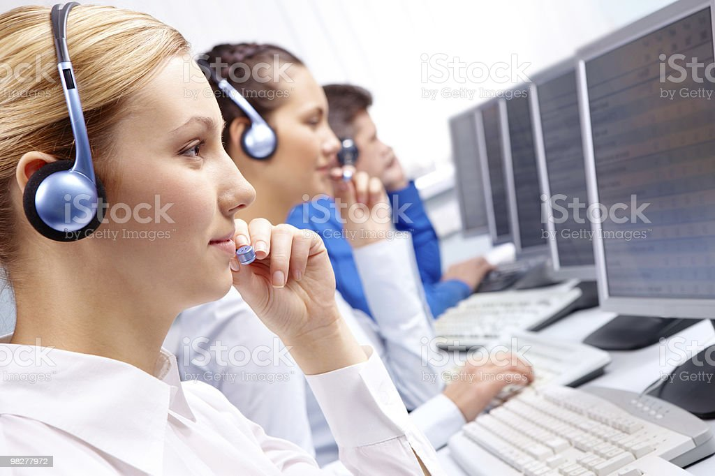 People wearing headphones work at computers royalty-free stock photo