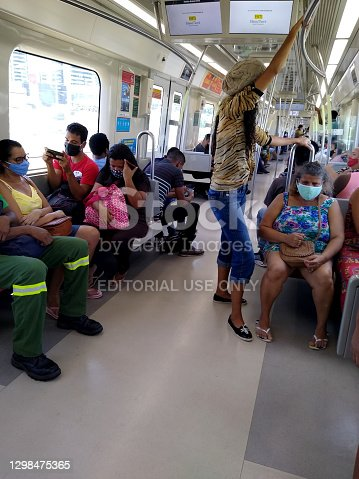 salvador, bahia, brazil - january 21, 2021: people not seen wearing facial masks in a subway car in the city of Salvador.