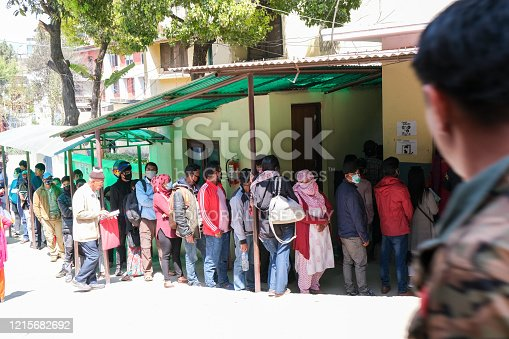 Kathmandu, Nepal, 16 March 2020: People wearing protecting masks outside a hospital, waiting for checkup for coronavirus and other health diseases  at Kathmandu in Nepal, Asia