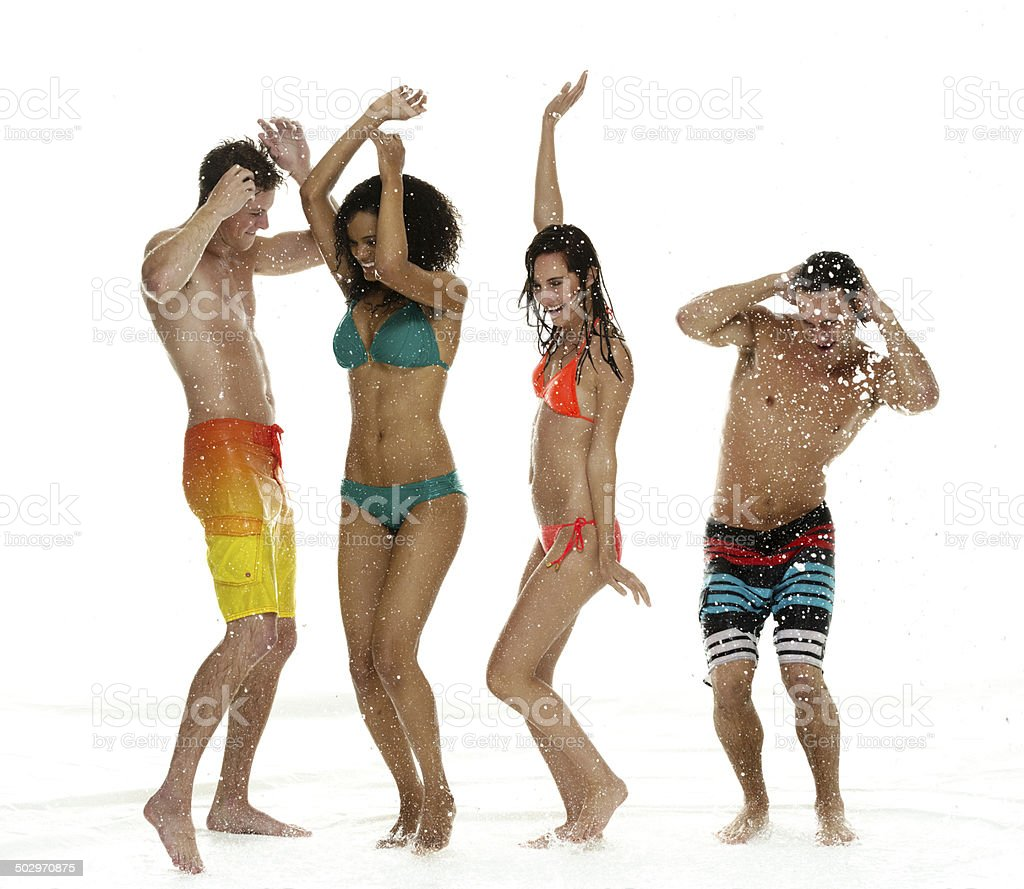 People wearing swimwear & dancing in the rain stock photo