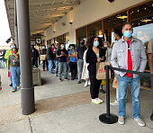 istock People wearing the mask and lining up in front of the store 1289113171