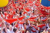 """""""Pamplona, Spain -July 6, 2012: Hands up with scarves, people welcome the opening of the San Fermin festival"""""""