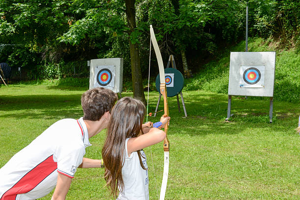 People who are learning to archery at Massagno on Switzerland stock photo