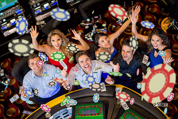 People winning at the casino Happy group of people winning at the casino game of chance stock pictures, royalty-free photos & images