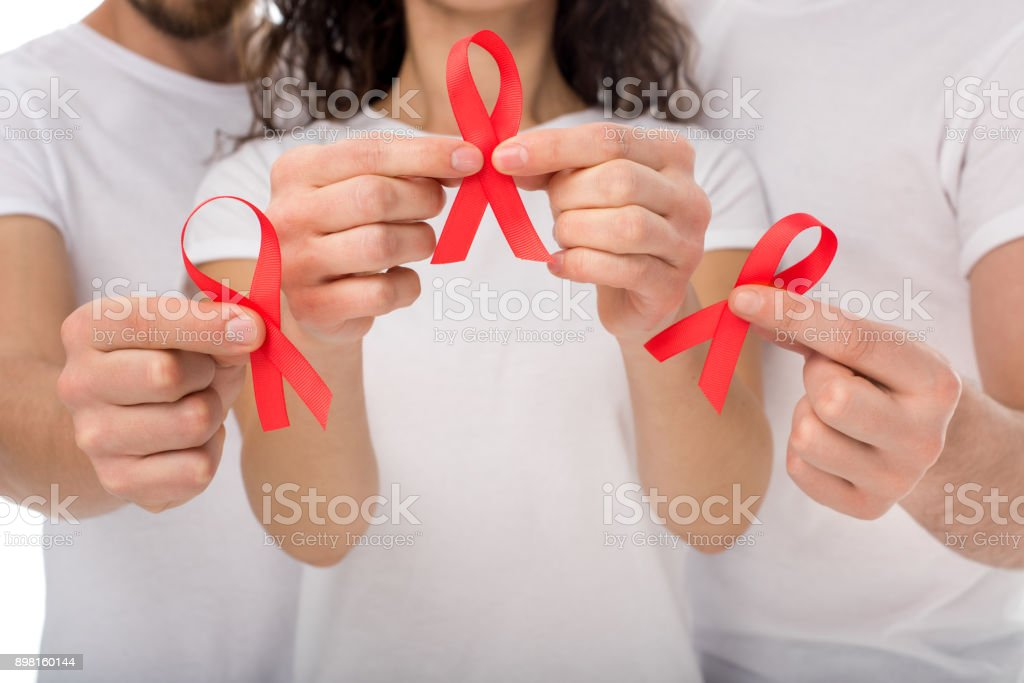 people with aids ribbons in hands stock photo