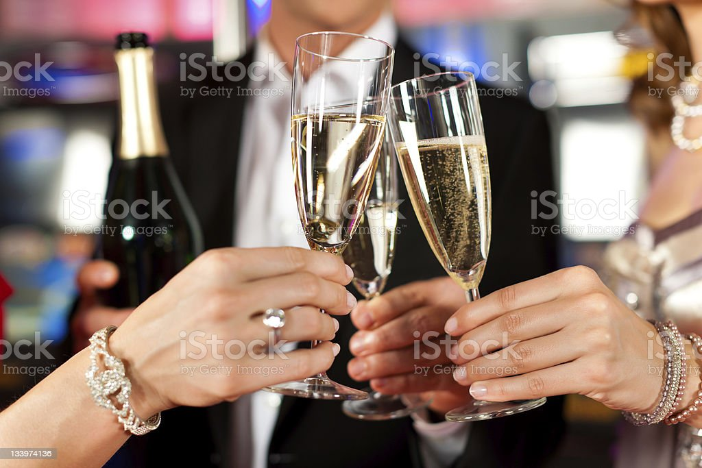 People with champagner in a bar stock photo