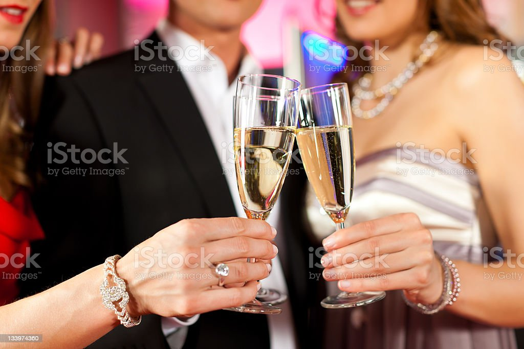 People with champagner in a bar royalty-free stock photo