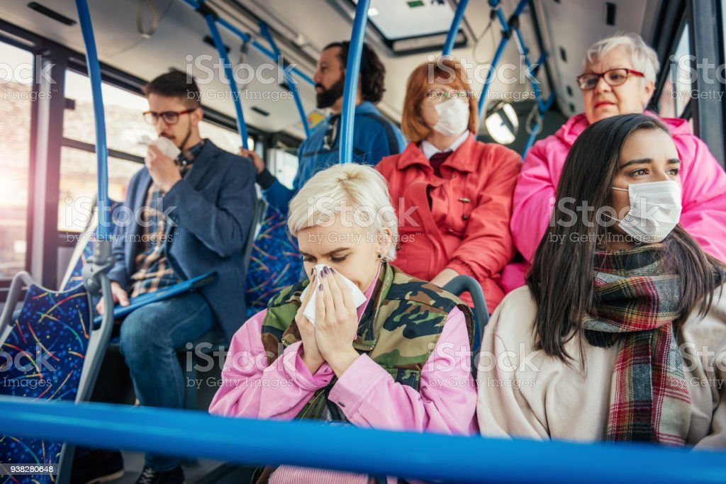 People with flu traveling by public bus stock photo