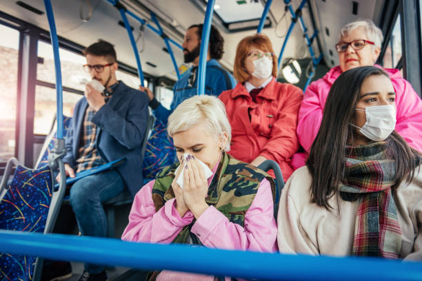 people with flu traveling by public bus - infectious disease stock pictures, royalty-free photos & images