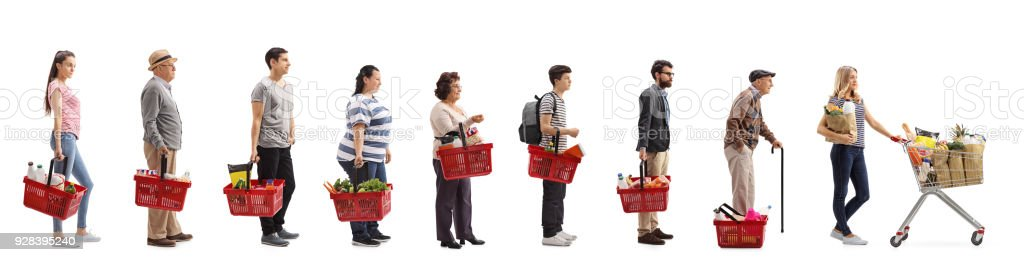 People with groceries waiting in line stock photo