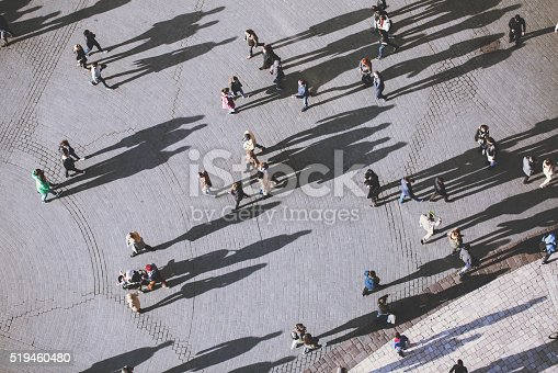 istock People with lolg shadows, top view 519460480