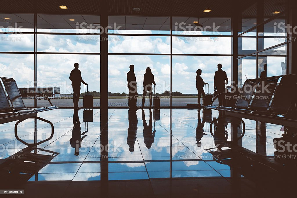 People with luggage waiting at airport lounge – Foto