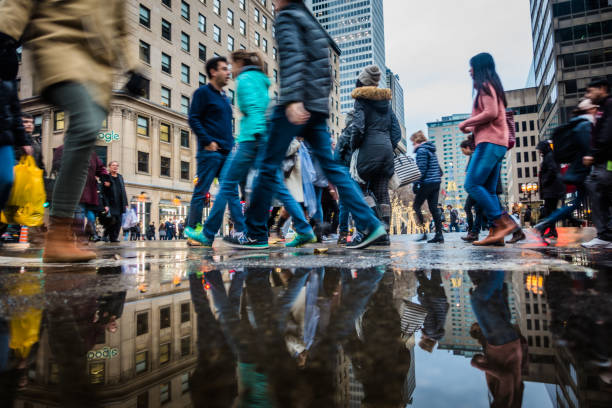 People with Motion Blur Walking Fast During Shipping Hour on Ste-Catherine Street before Xmas stock photo