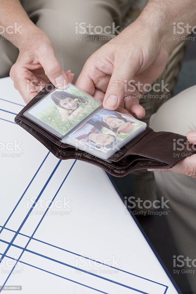 People with photographs in wallet royalty-free stock photo