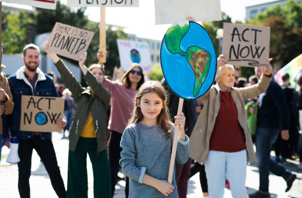 people with placards and posters on global strike for climate change. - sustainable living stock pictures, royalty-free photos & images