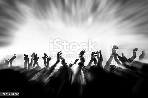 istock People with raised arms 502607652