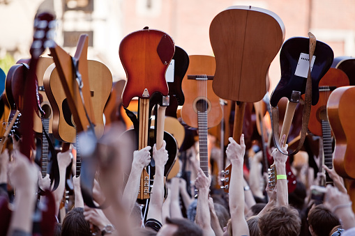 People With Raised Guitars Stock Photo - Download Image Now