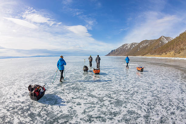 People with sledge and trekking pole is ice of Baikal stock photo