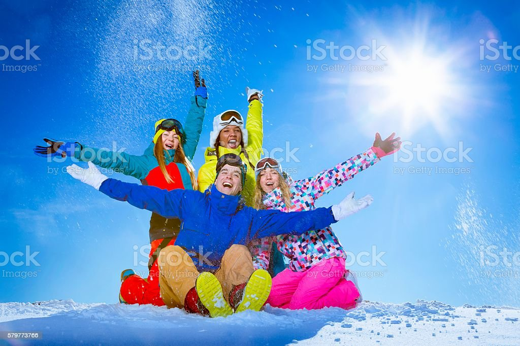 People with snowboards stock photo