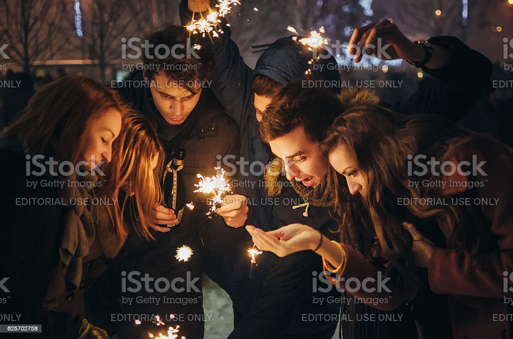 People with sparklers Christmas party outdoor stock photo