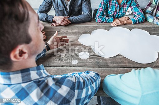 istock People with talking speech bubbles 539240220