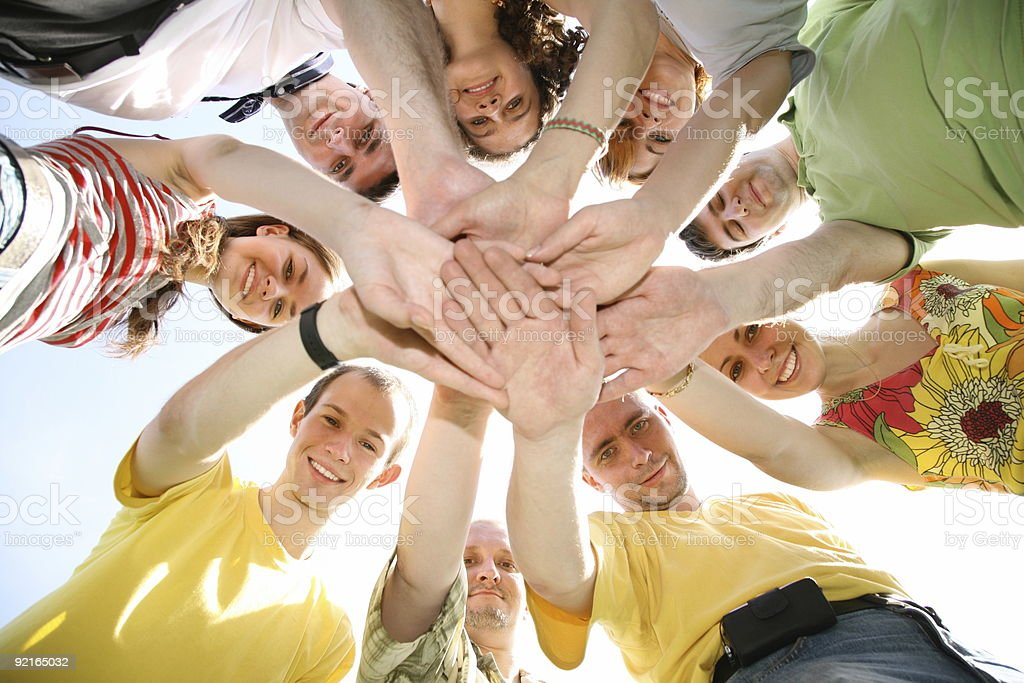 People with their hands on top of each other's hands royalty-free stock photo