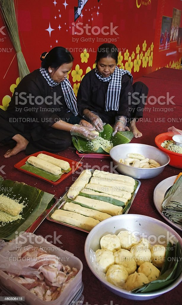 People with traditional Vietnamese dress making food stock photo