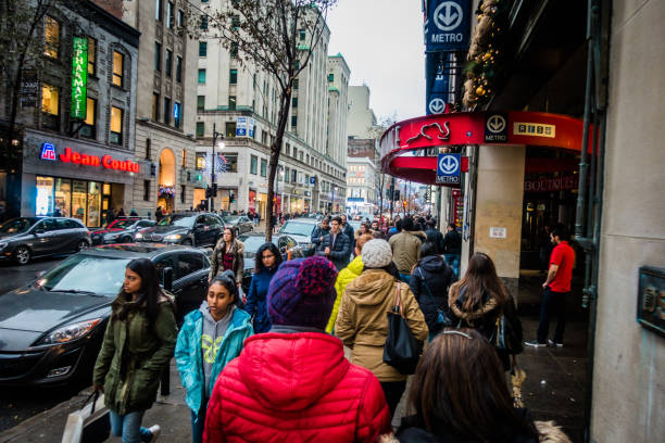People with Walking Fast During Shipping Hour on Ste-Catherine Street before Xmas stock photo