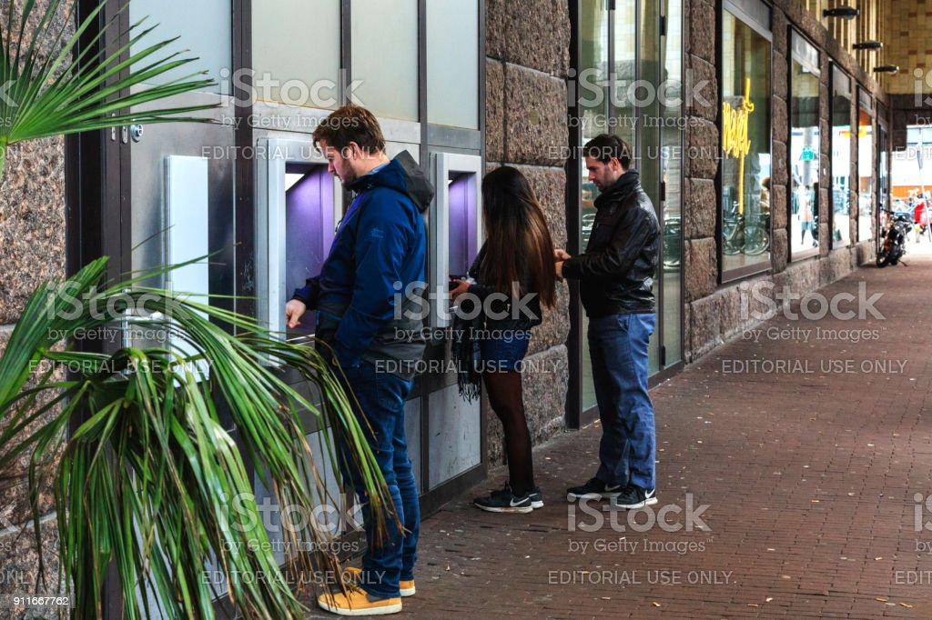 People withdraw cash ATM, Amsterdam stock photo