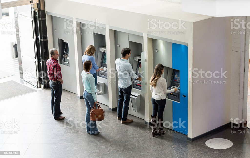 People withdrawing cash at an ATM stock photo