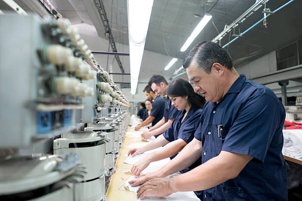People working at an embroidery factory - foto de stock