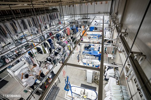 People working at an industrial laundry service - View from above