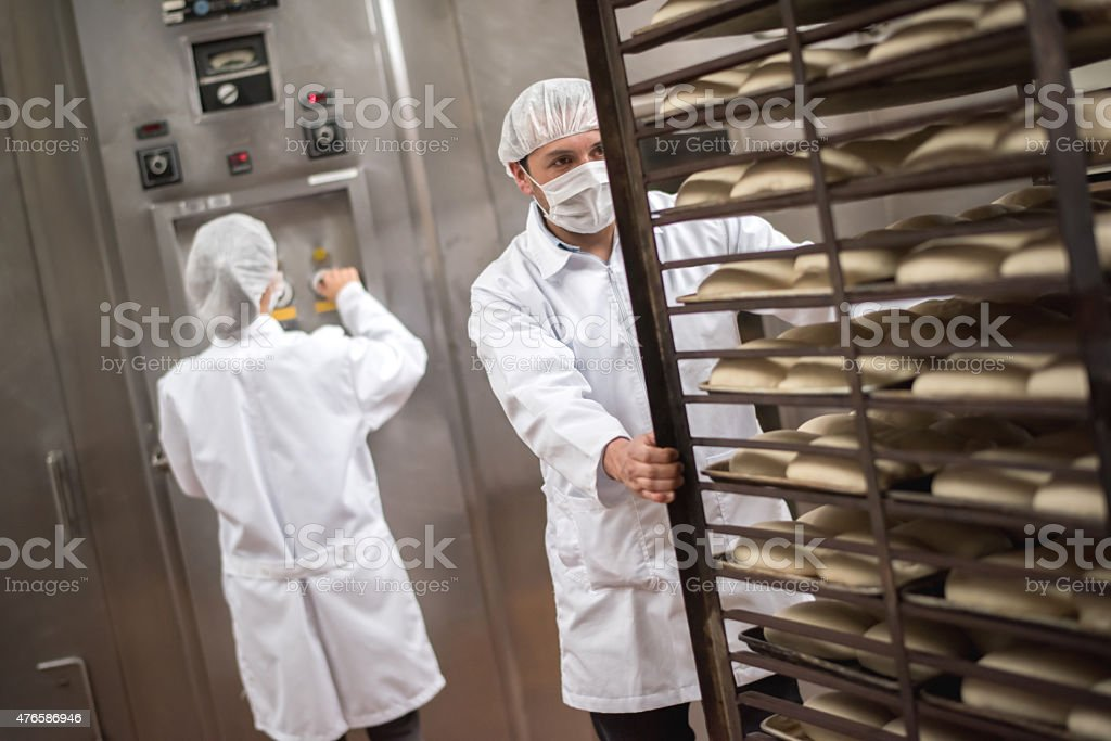 People working at an insdustrial bakery stock photo